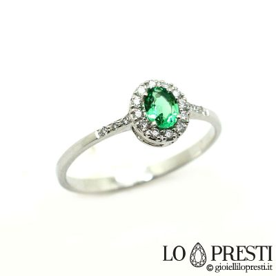 ring with natural and brilliant cut diamonds emerald